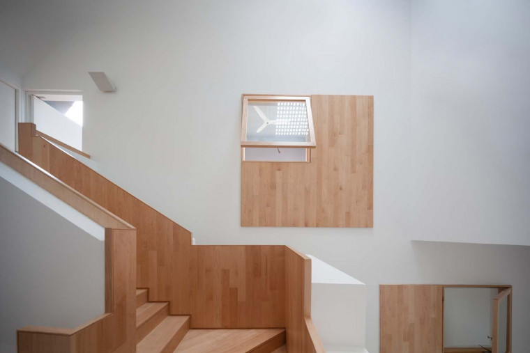 ipli Architects Arranges Square Openings on a House to Control Natural Light and Ventilation