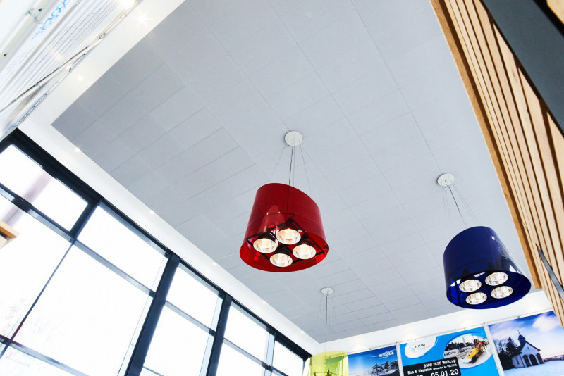 Concrete grey acoustic ceiling solutions helps train station in Winterberg win an award